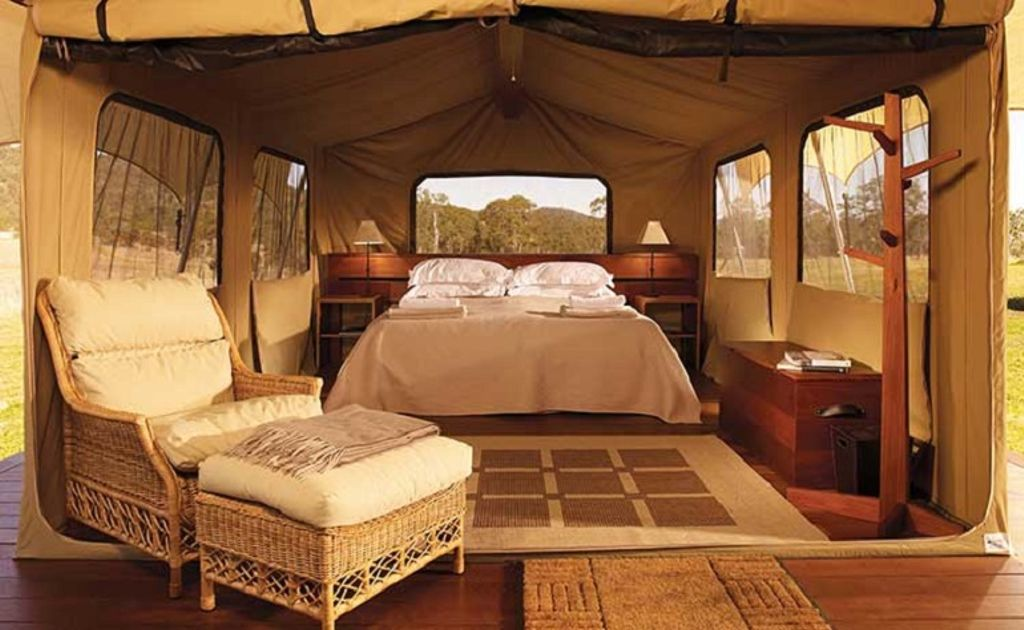 Go camping in Australia with this incredible glamping tent, complete with chair and double bed