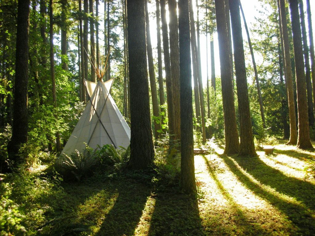Exterior of cozy Oregon tipis for best nature travel destinations in the US