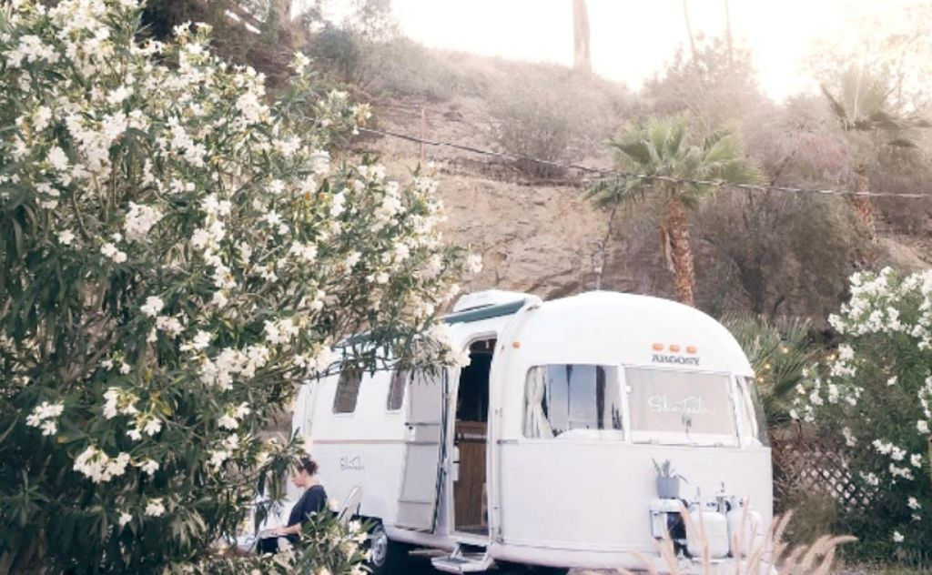 airtream rental Palm springs in shadow of mountains ideal for romantic getaways California