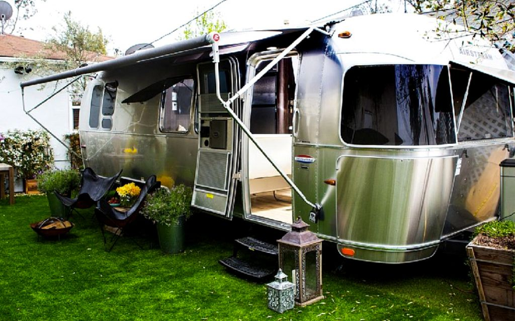 Classic luxury camping rental California with doors open, inviting for family glamping CA near Los Angeles