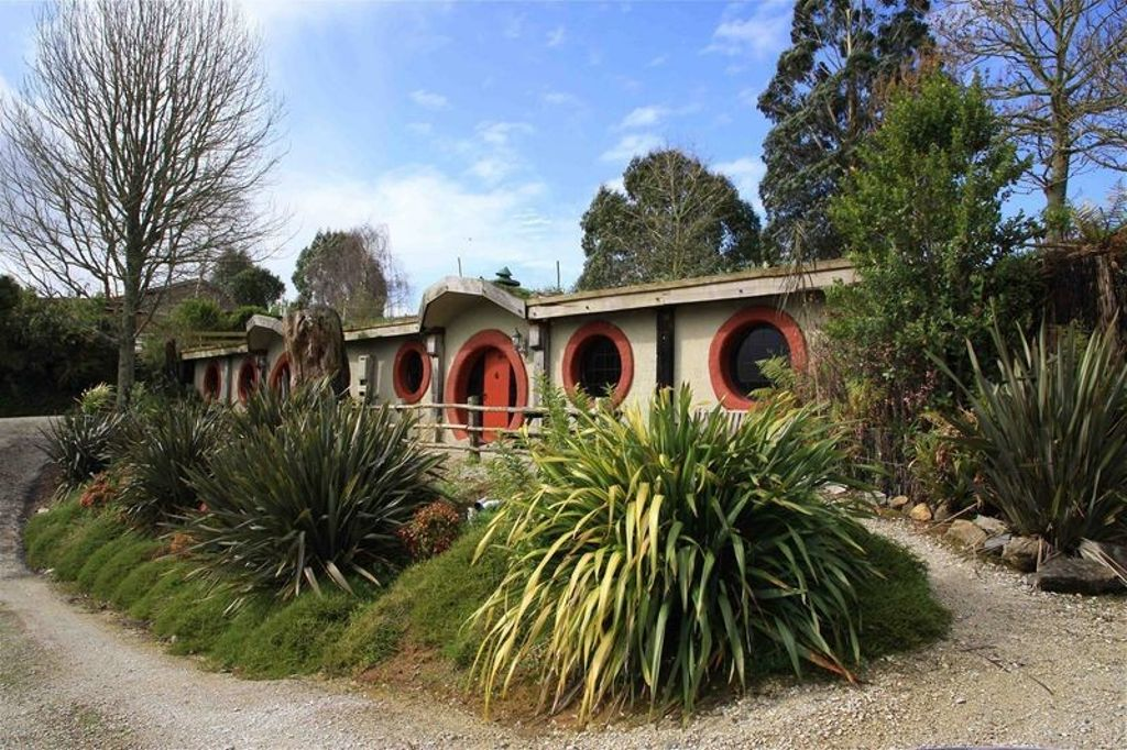 New Zealand top attractions include this authentic hobbit house for rent in NZ