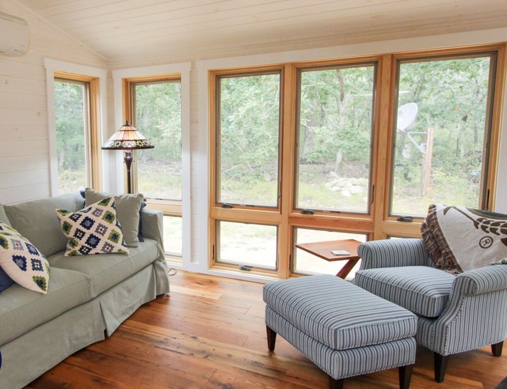 A sofa and armchair to cozy up in at this luxury rental in Martha's Vineyard, Massachusetts.