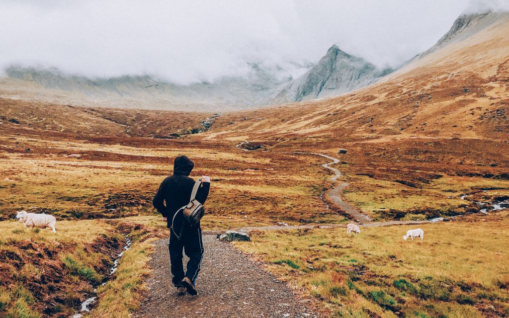 A man going on a hike in Scotland.