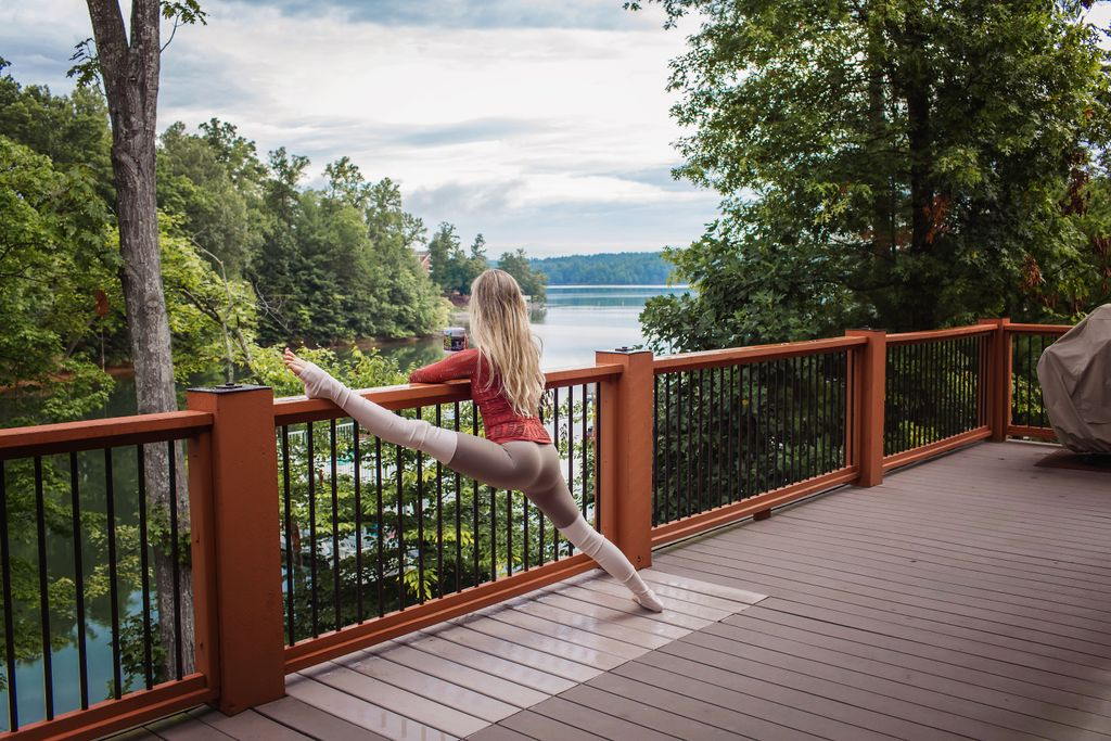 Megan stretches on the patio while enjoying the stunning view of Lake James.