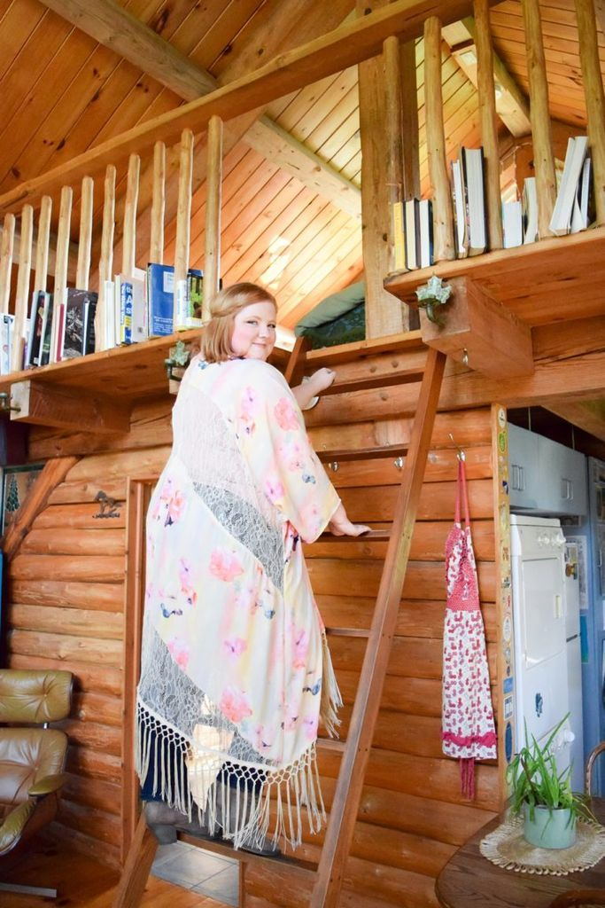Liz climbs up to the cozy cabin's elevated bedroom.