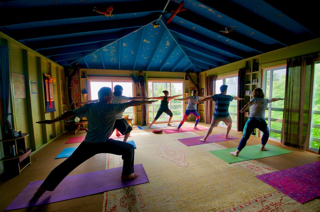 A group of glampers doing yoga in one of the property's yoga facilities.