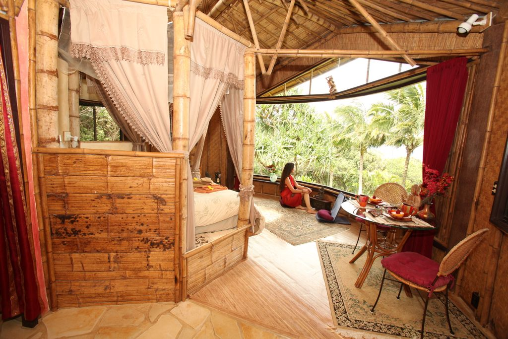A lovely view of the interior of an eco-friendly, bamboo cottage at this glamping site in Maui.
