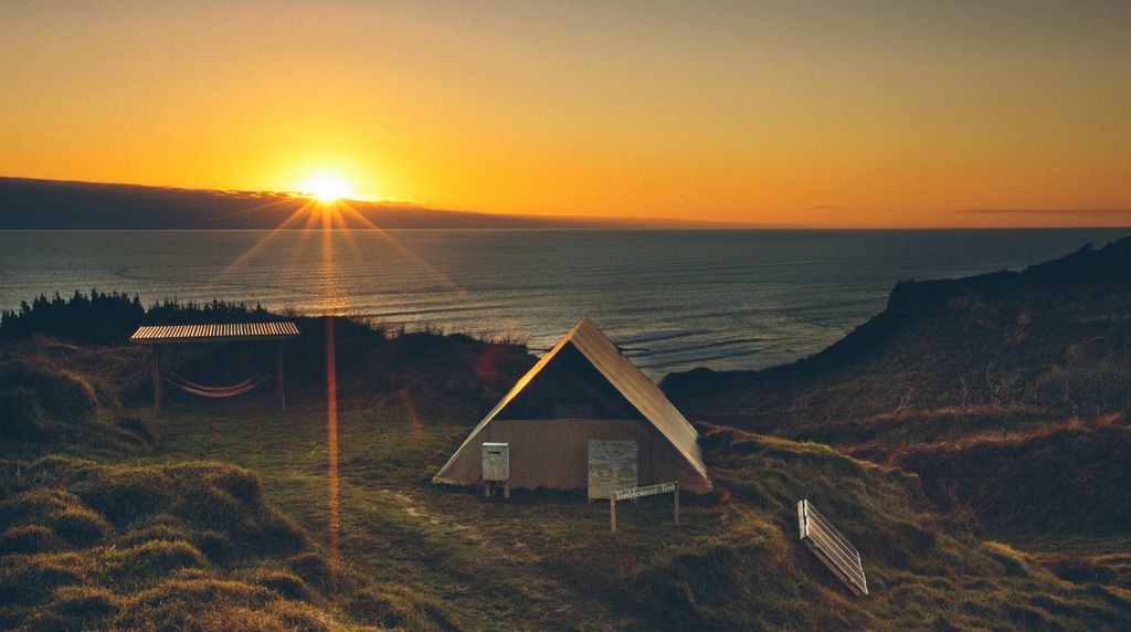 Luxury Tent Resort and Tree House Paradise above Karioitahi Beach, New Zealand