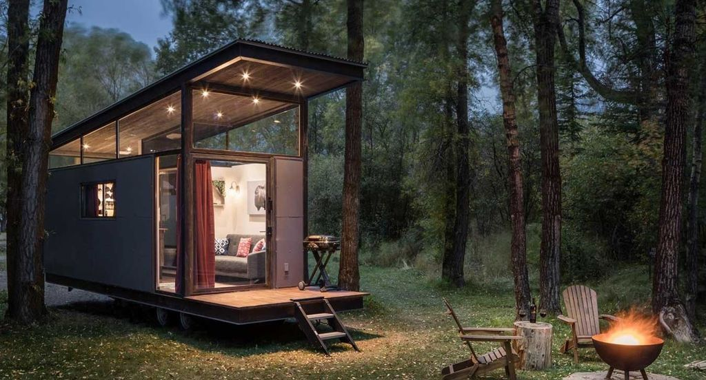 The tiny house from the outside at nighttime.