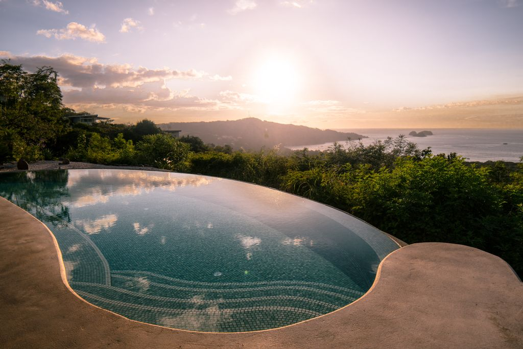 Infinity pool with view of Palo Verde National Park