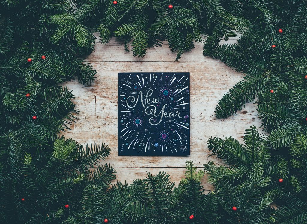 A holiday wreath with a New Year's message for best places to visit in 2020