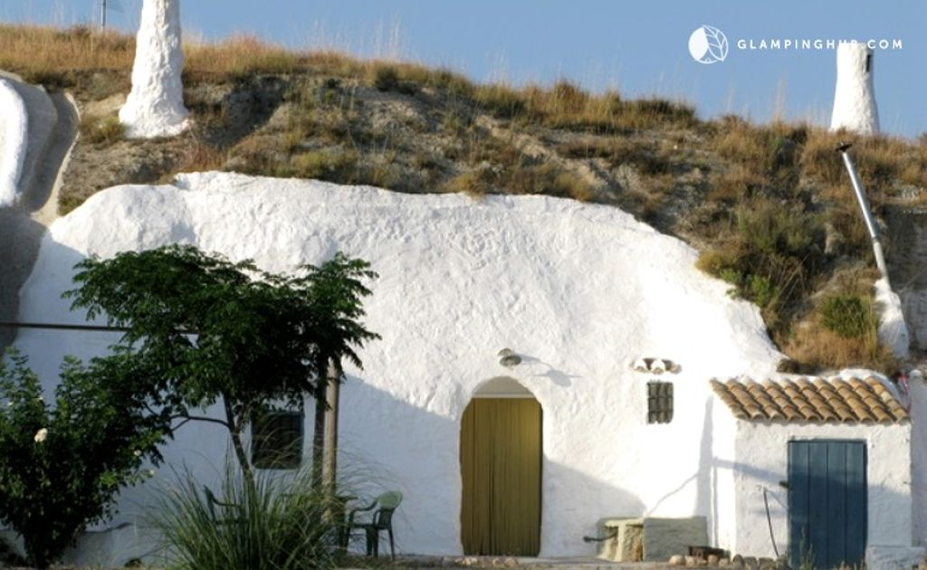 A view of the exterior of one of the cave hotels in Granada situated in one of the best places to visit in 2020