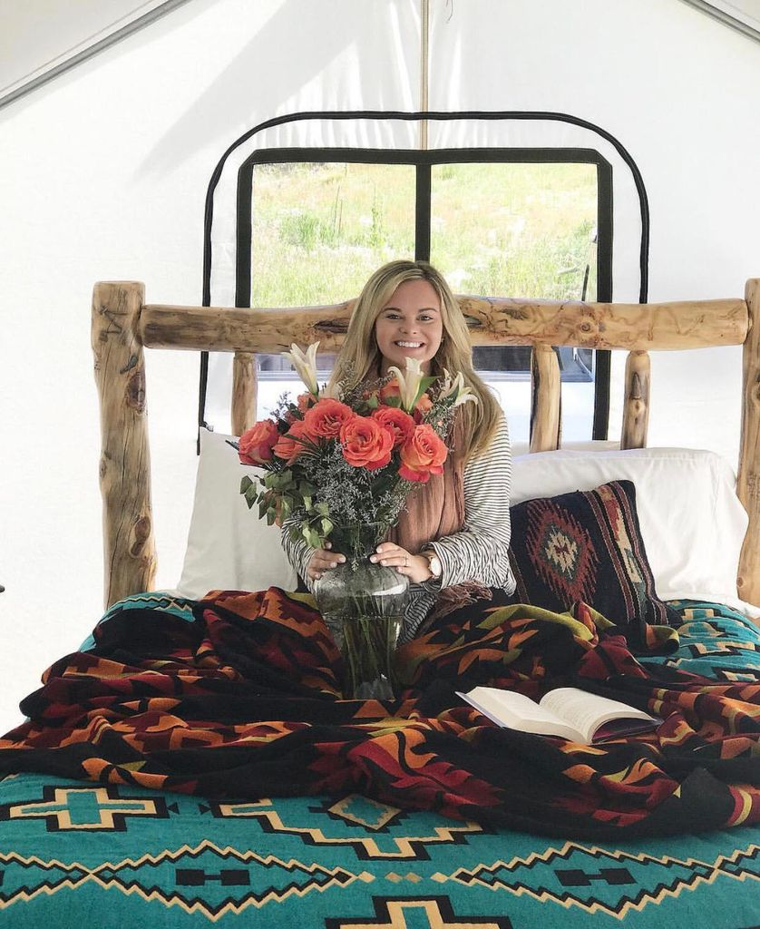 Jordan with flowers, part of a Valentine's Day story spend luxury camping, Colorado