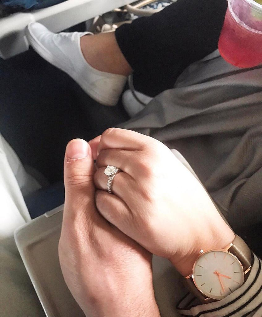 The engagement ring on hand of couple during a valentine's day true story