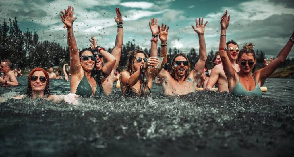 friends enjoying the secret solstice festival Iceland has to offer