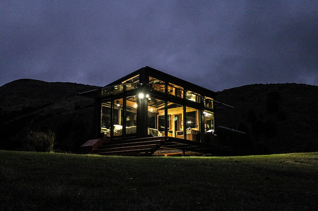 A New Zealand accommodation alone in a field at night.