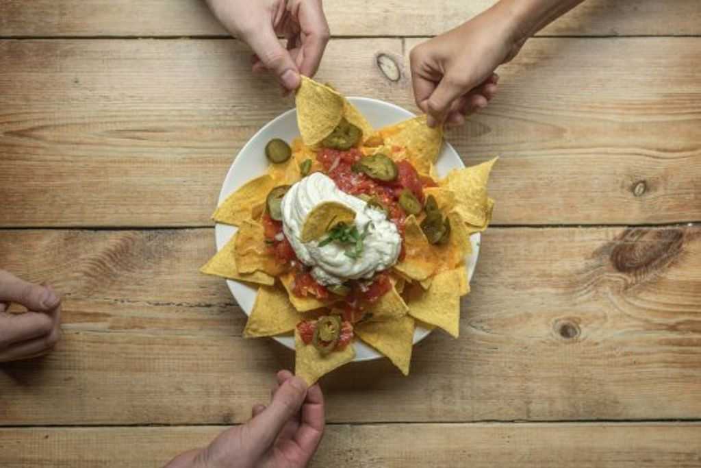 a plate of nachos being shared and some of the best leftover ideas