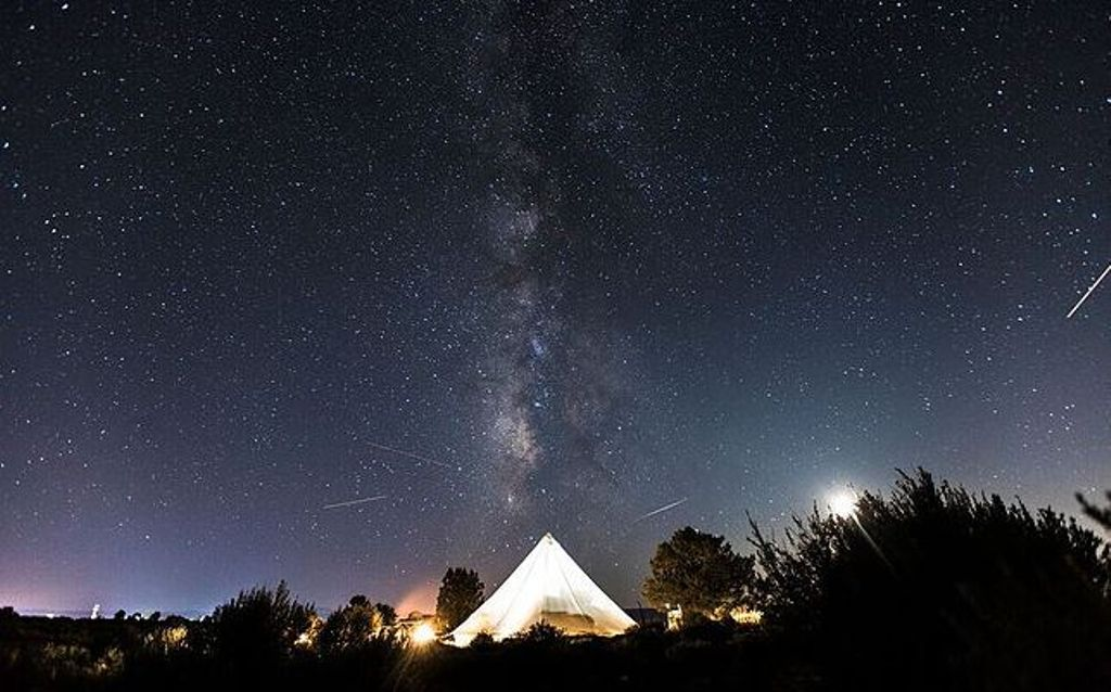 A Utah bell tent rental at night under the starry skies of Zion National Park.