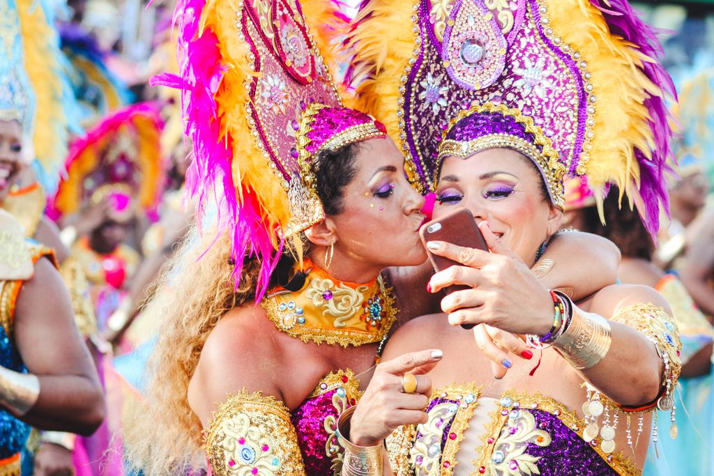 two women in traditional mardis gras costumes at the fat tuesday carnival, mardis gras