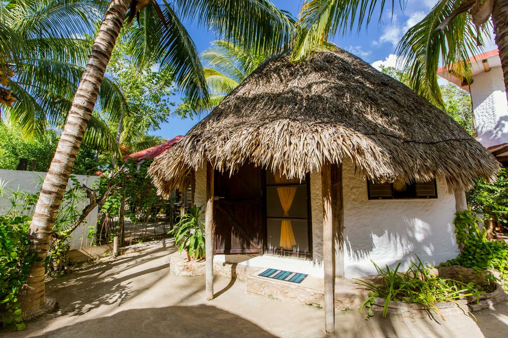 Stay in a beach hut on Isla Holbox, Mexico, for the perfect babymoon vacation