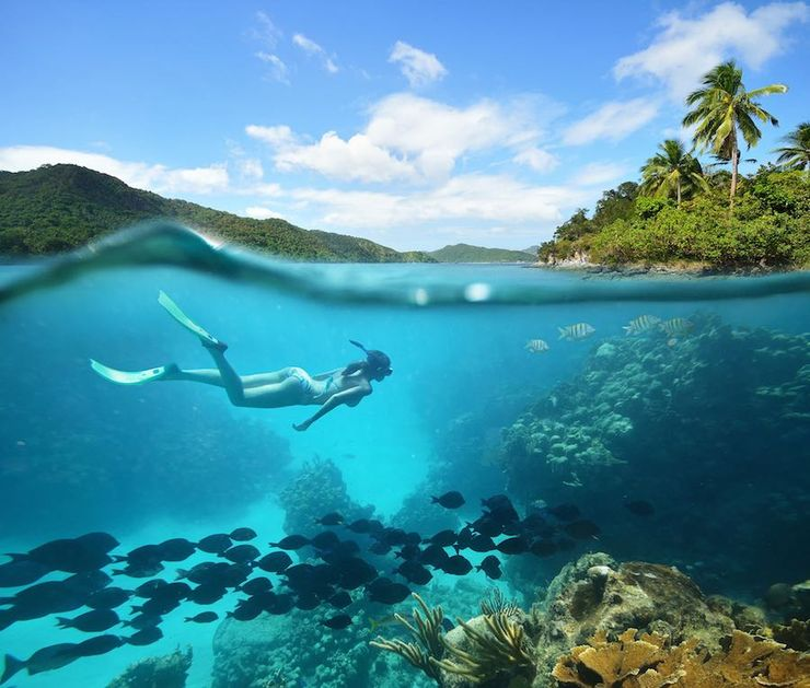 woman enjoying Fernando de Noronha snorkeling and one of the best things to do in Brazil