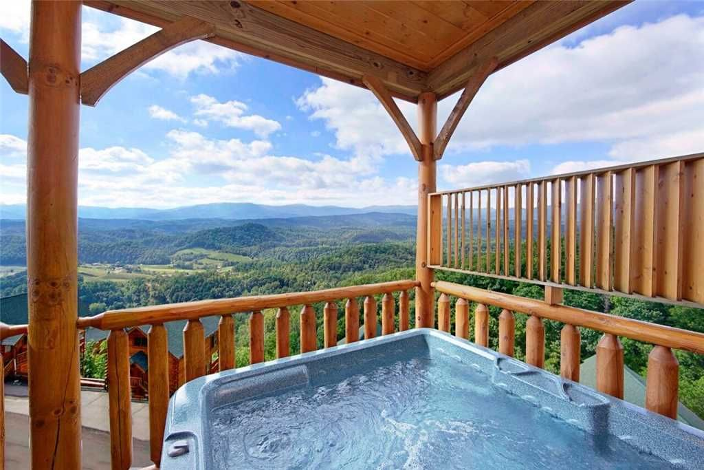A Pigeon Forge cabin rental with a private hot tub looking out over the mountains.