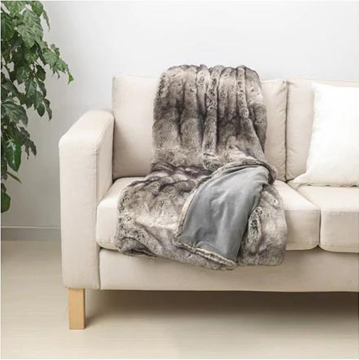 A couch with blankets and throws