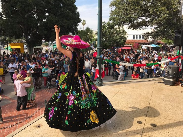 woman dancing and enjoying cinco de mayo events los angeles has to offer to the public