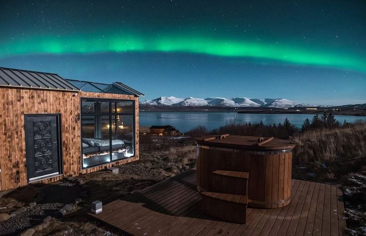 A vacation in Iceland at this glass cabin rental with a hot tub for sustainable tourism.