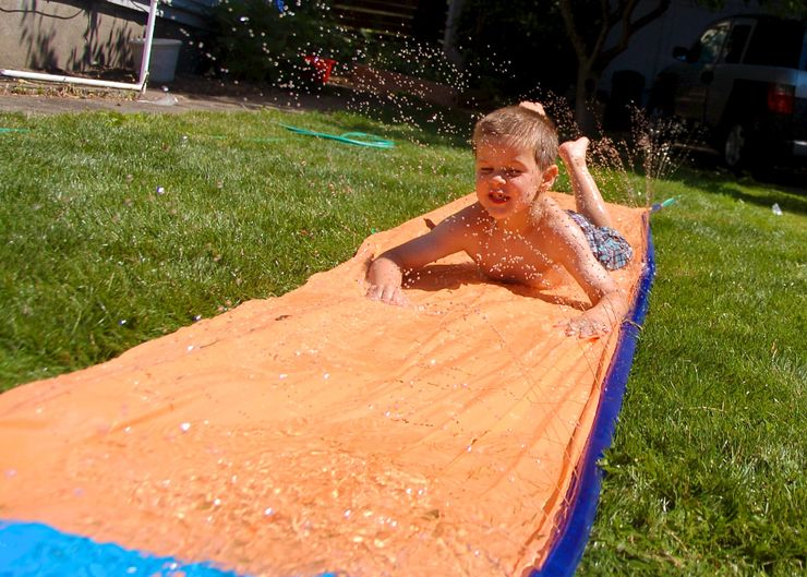 child enjoying DIY slip and slide and summer fun for kids